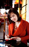 Woman planning her day in a cafe Royalty Free Stock Photography