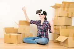 Woman planning home with VR headset Stock Photography