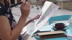Woman planning summer vacation trip, examining city map, tourism, travel. Stock footage stock video footage