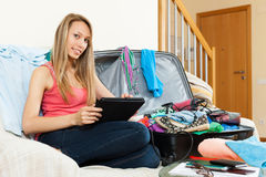 Woman planning a vacation and journey on a tablet Royalty Free Stock Photography