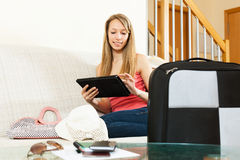 Woman planning a vacation and journey on a tablet Royalty Free Stock Photos