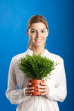 Woman with a Plant Royalty Free Stock Image