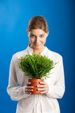 Woman with a Plant Stock Photography