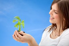Woman with a plant Royalty Free Stock Photo