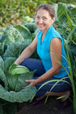 Woman  in plant of cabbage. Mature woman  in plant of cabbage Royalty Free Stock Photography
