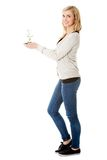 Woman with plant and dirt in hand Stock Image