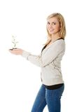 Woman with plant and dirt in hand Royalty Free Stock Image