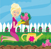 Woman plant flowers in the garden Royalty Free Stock Photos