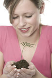 Woman with plant in soil Royalty Free Stock Images