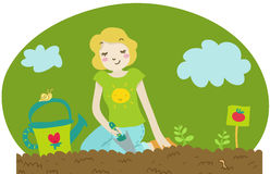 A woman plant tomato seedling. A young blond woman plants tomato seedling Royalty Free Stock Photo