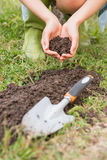 Woman planting in a field Stock Photo