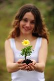 Woman planting a flower. In nature smiling royalty free stock photos