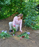 Woman planting flowers in  garden Royalty Free Stock Photography