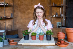 Woman with plants in flowerpots Royalty Free Stock Images