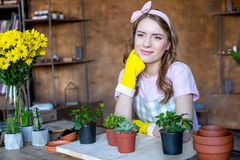 Woman with plants in flowerpots Royalty Free Stock Photo