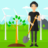 Woman plants tree. Royalty Free Stock Photography