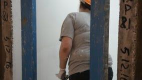 Woman plasterer trowel concrete slab stock video