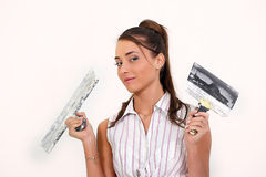 Woman plastering the wall Stock Image