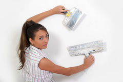 Woman plastering the wall Stock Images