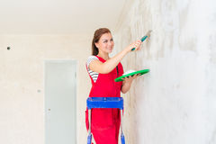 Woman plastering wall Royalty Free Stock Photo