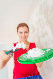 Woman plastering wall Royalty Free Stock Image