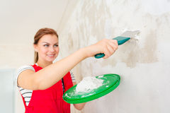 Woman plastering wall Royalty Free Stock Photography