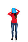 Woman with plastic bucket on head. Stock Photography