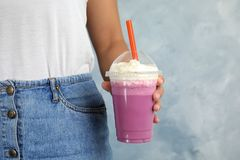 Woman with plastic cup of tasty milk shake stock images