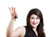 Woman with a plastic spider Stock Image