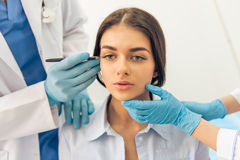 Woman at the plastic surgeon Stock Images
