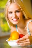 Woman with plate of fruits Royalty Free Stock Image
