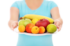 Woman with a plate of fruits Stock Photo
