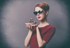 Woman with plate full of chocolate candies Royalty Free Stock Image