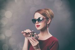 Woman with plate full of chocolate candies Royalty Free Stock Photography