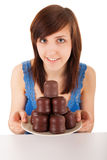 The woman with a plate full of chocolate marshmallow Stock Photography