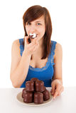 The woman with a plate full of chocolate marshmallow Stock Images