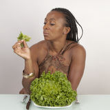 Woman with plate full of lettuce Royalty Free Stock Photo