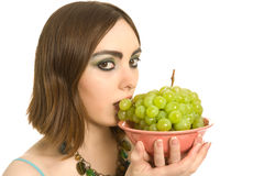 Woman with a plate  of green grapes Stock Photo