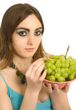 Woman with a plate  of green grapes Royalty Free Stock Photo
