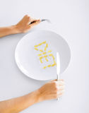 Woman with plate and meds Stock Photos