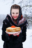 Woman with a plate of pancakes Stock Images