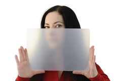Woman plate. Woman in red holding a transparent plate half hiding her face as if providing copyspace Stock Images