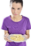Woman with plate of spaghetti Stock Photography
