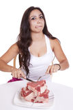 Woman with plate of steaks licking. Stock Photos