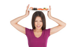 Woman with plate of sushi. Royalty Free Stock Photos