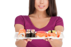 Woman with plate of sushi. Royalty Free Stock Image