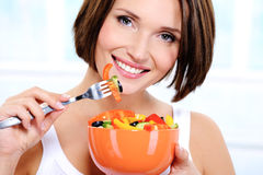 Woman with a plate of  vegetable salad in hands Royalty Free Stock Images