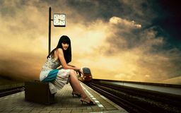 Woman on the platform. Woman waiting train on the platform of railway station Stock Photography