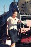 Woman on the platform near the retro train Royalty Free Stock Photos