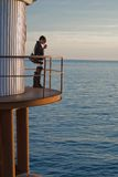 Woman on platform by sea Royalty Free Stock Images